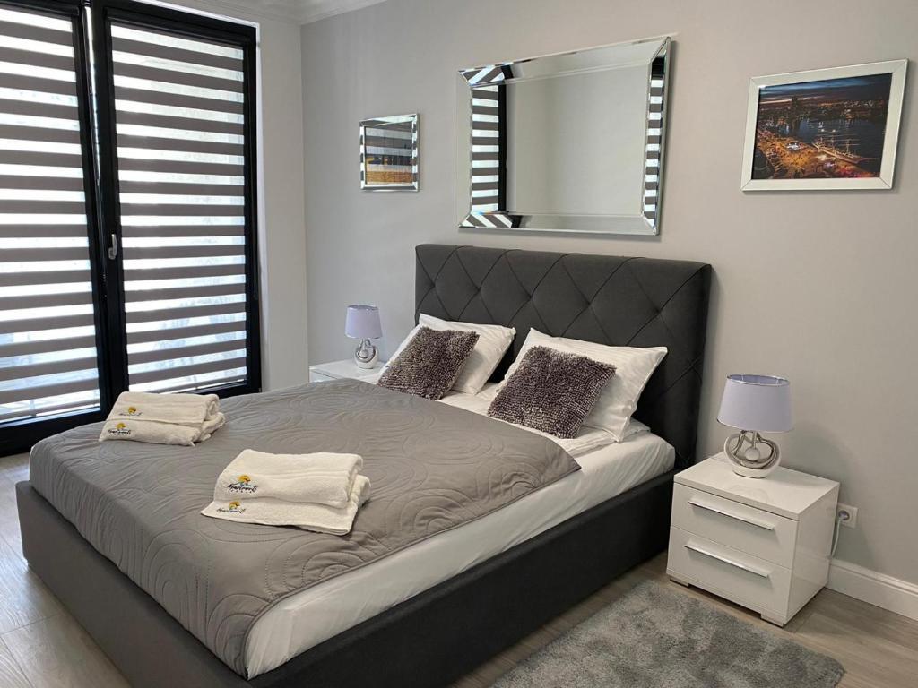 Postel nebo postele na pokoji v ubytování Apartament Daria Portova