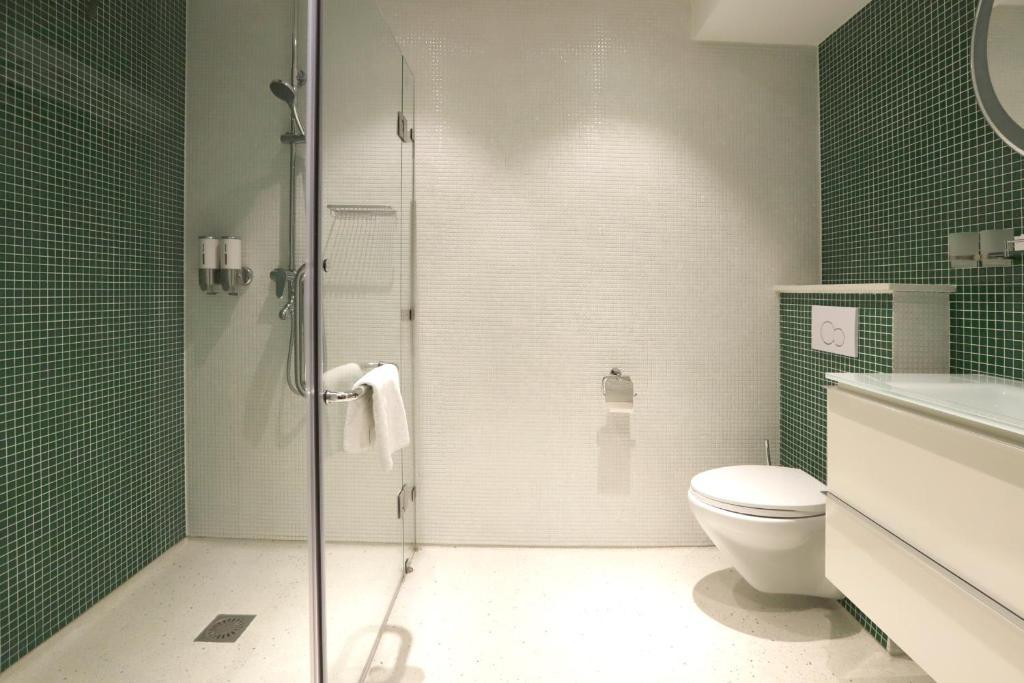 Um banheiro em Chasse Hotel