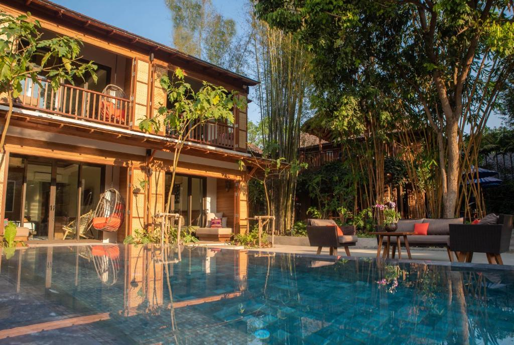 The swimming pool at or close to Pai Village Boutique Resort
