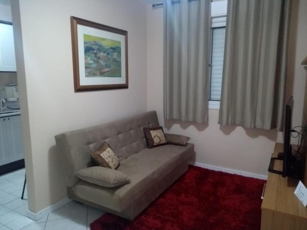 A seating area at Apartamentos funcional II