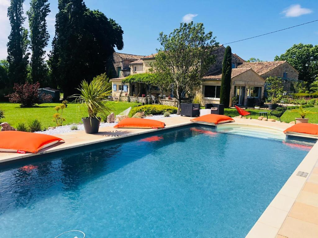 The swimming pool at or near Guest House La Bastide des Bourguets