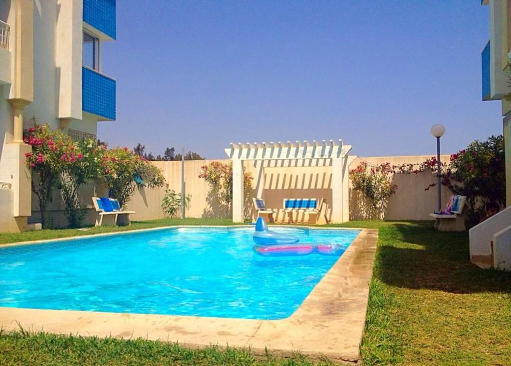 The swimming pool at or near Apartment with 2 bedrooms in Hammamet with wonderful sea view shared pool balcony 100 m from the beach