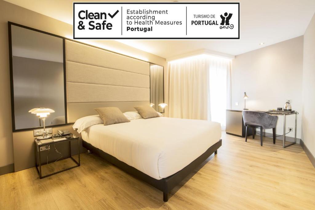 Cama o camas de una habitación en Zenit Lisboa
