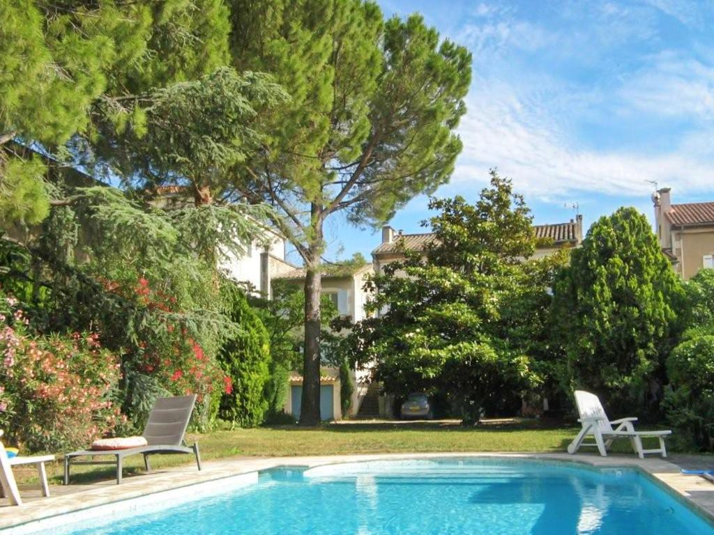 The swimming pool at or near Apartment with one bedroom in SaintRemydeProvence with shared pool enclosed garden and WiFi