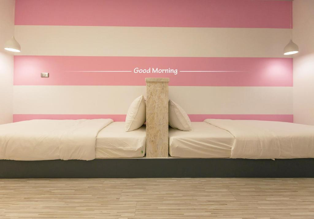 ベイハウス コンフォーテル 花蓮 ホステルにあるベッド