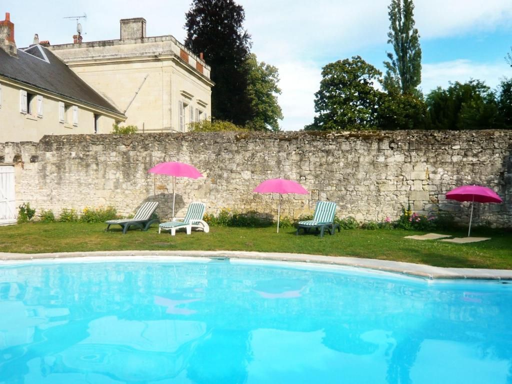 The swimming pool at or near Mansion with 6 bedrooms in Neuillé, with private pool, furnished garden and WiFi