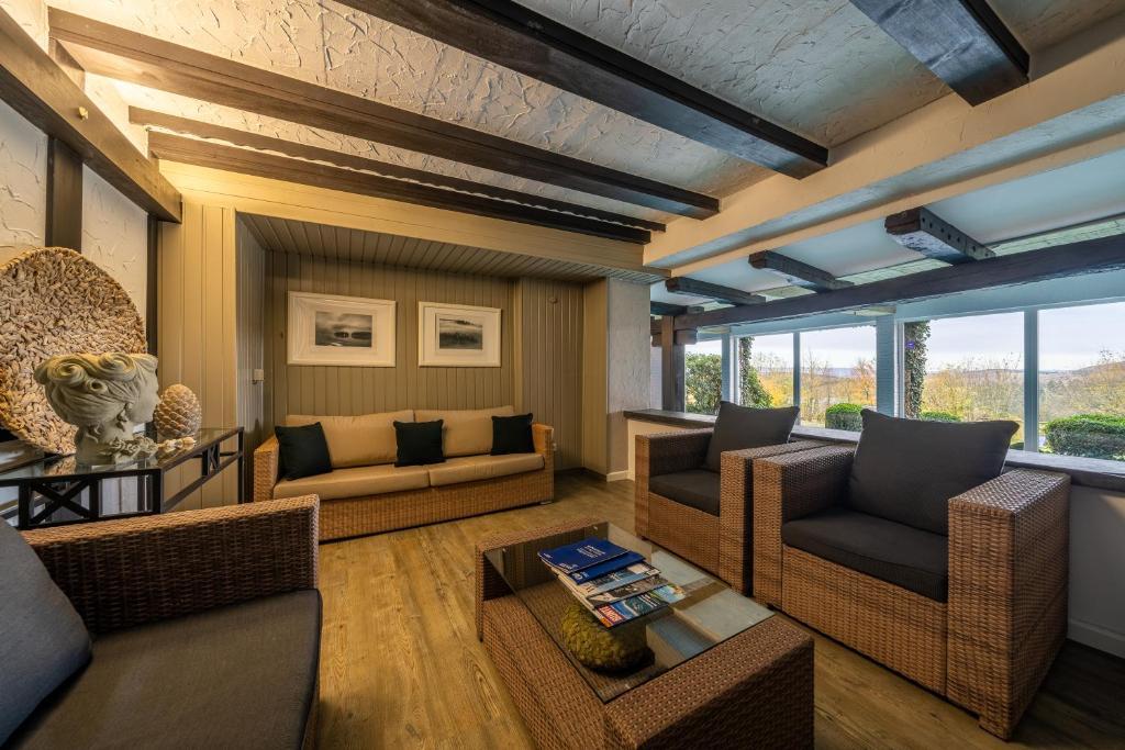 Ein Sitzbereich in der Unterkunft Hotel Albus
