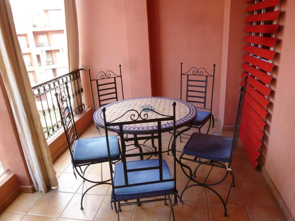 A balcony or terrace at Apartment with 2 bedrooms in Marrakech, with shared pool and WiFi