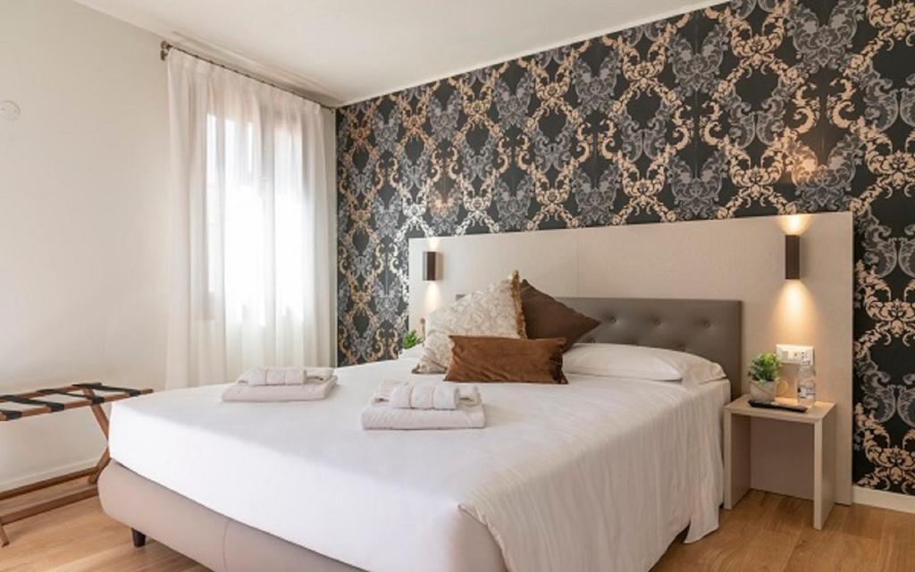 Letto o letti in una camera di Grifoni Boutique Hotel