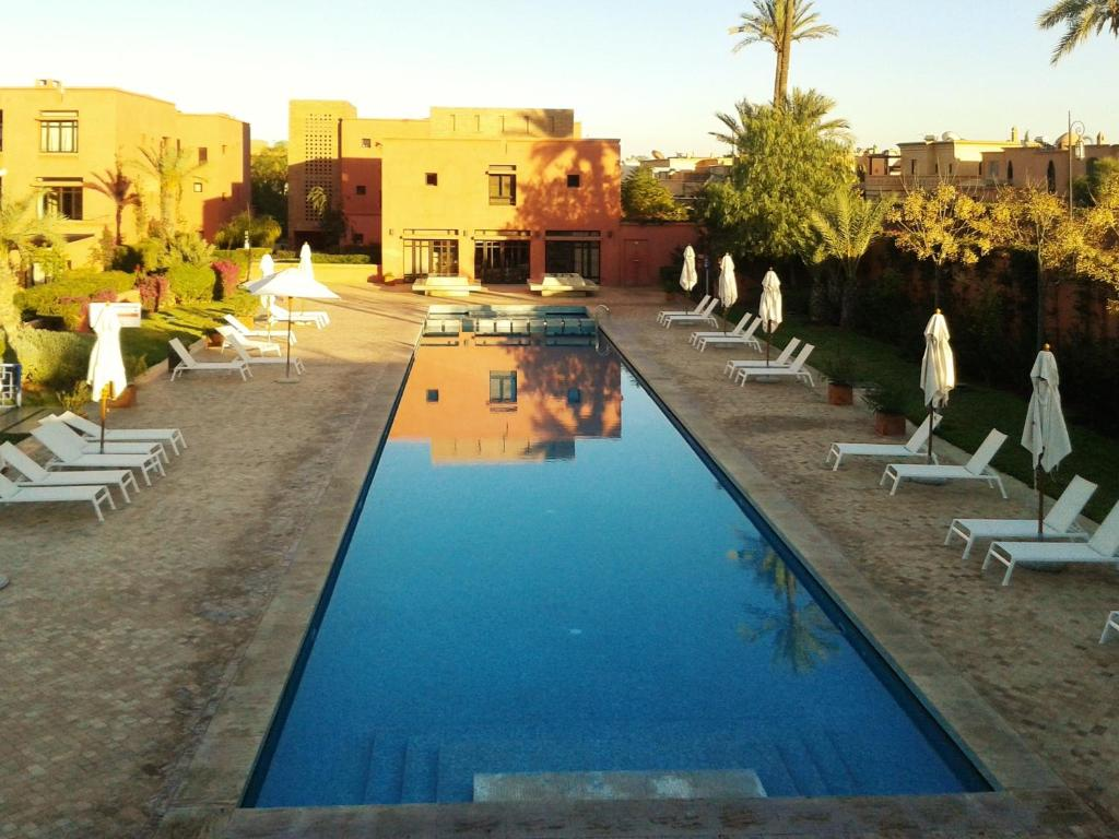 The swimming pool at or near Apartment with 2 bedrooms in Marrakech with shared pool furnished terrace and WiFi 185 km from the beach