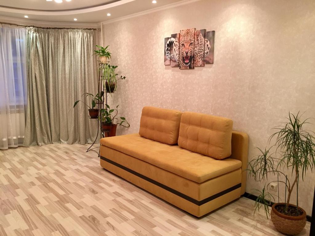 A seating area at Двухкомнатные апартаменты на Талсинской