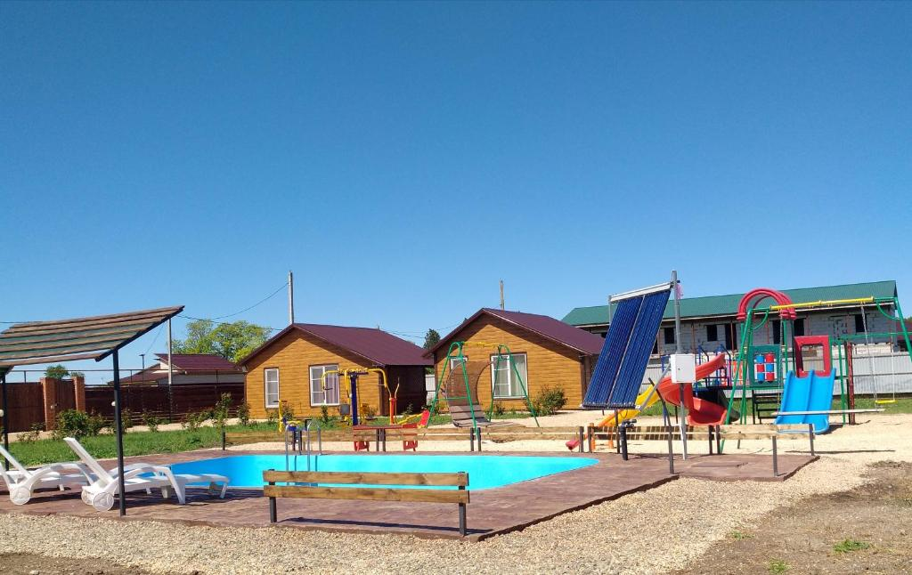The swimming pool at or near Guest House Gostevoy dvor