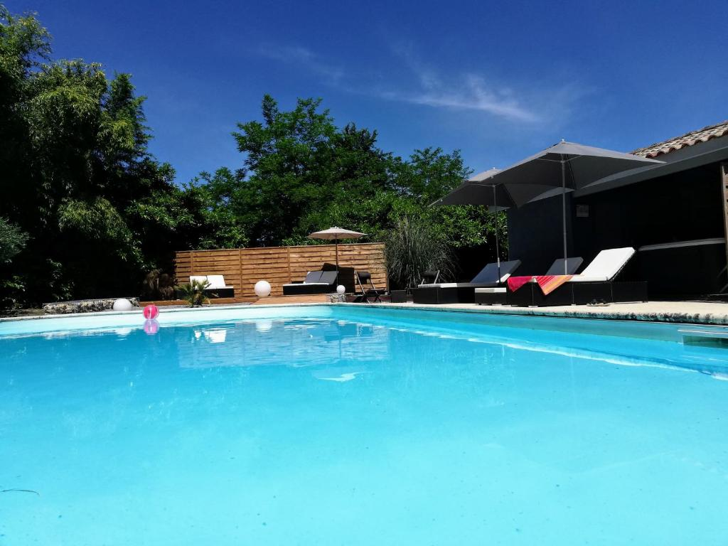 The swimming pool at or near Villa Corterra Sauternes