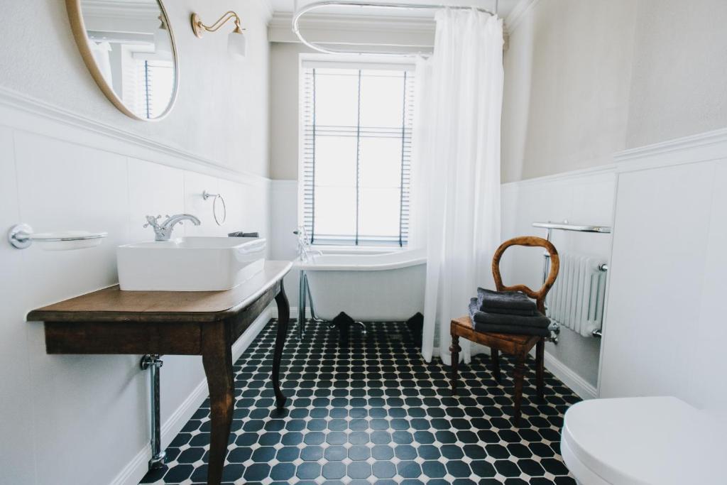Vannas istaba naktsmītnē VP apartamenti VALMIERA