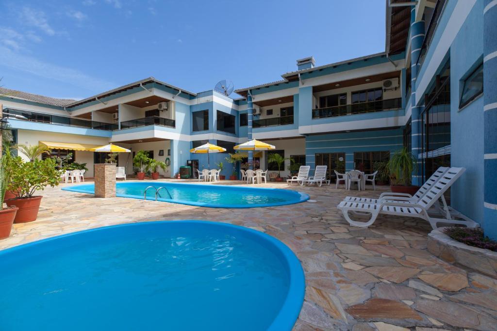 A piscina localizada em Pousada Caracol II ou nos arredores