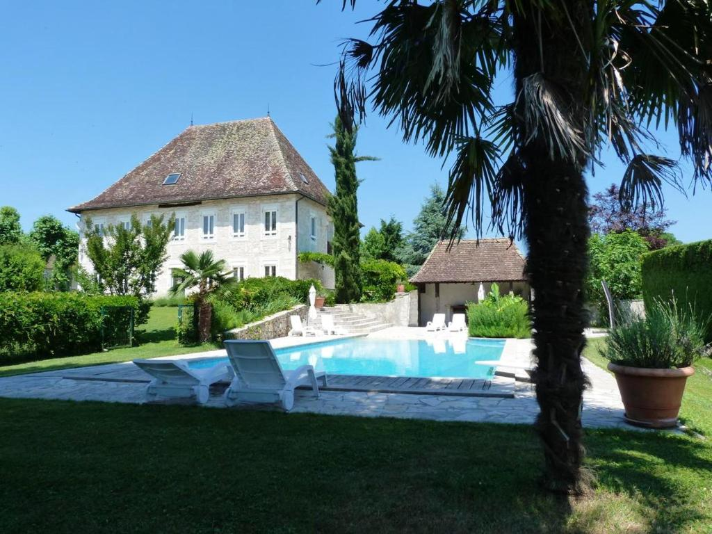 The swimming pool at or near Mansion with 4 bedrooms in LES AVENIERES VEYRINS THUELLIN with wonderful mountain view private pool enclosed garden