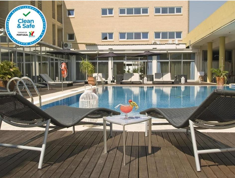 The swimming pool at or near Hotel de Ilhavo Plaza & Spa