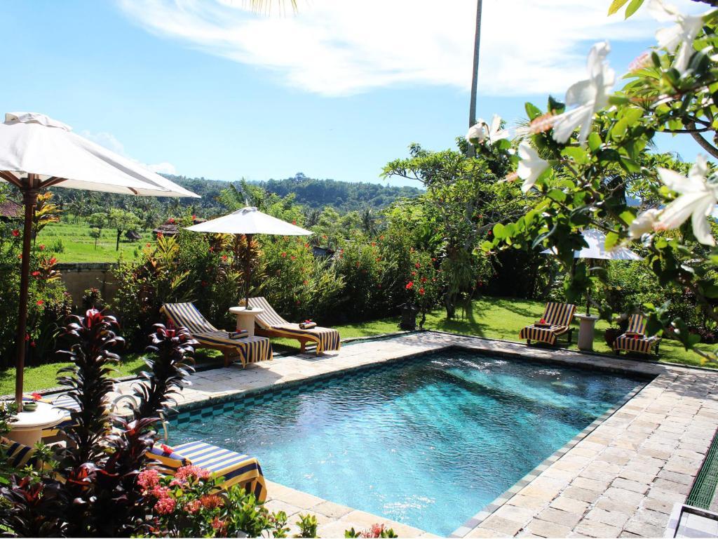 The swimming pool at or near Puri Bagus Manggis