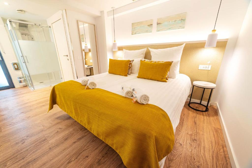 Ein Bett oder Betten in einem Zimmer der Unterkunft Hotel The Place - Adults Only