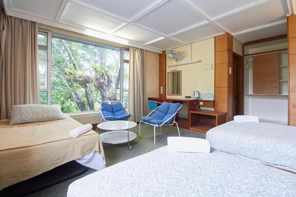 Ein Sitzbereich in der Unterkunft Bellevue The Penang Hill Hotel