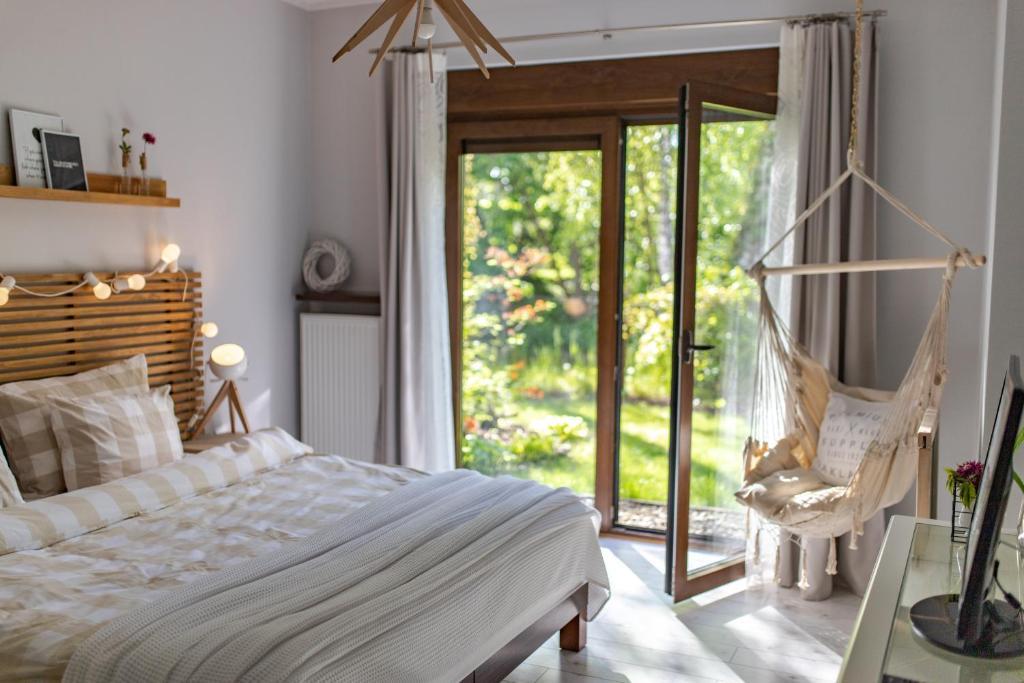 Łóżko lub łóżka w pokoju w obiekcie Apartament Willa Port Zacisze