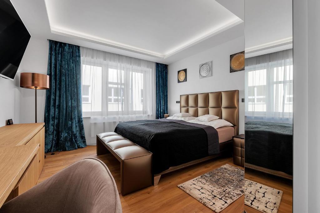 Postel nebo postele na pokoji v ubytování Nový designový apartmán s klimatizací