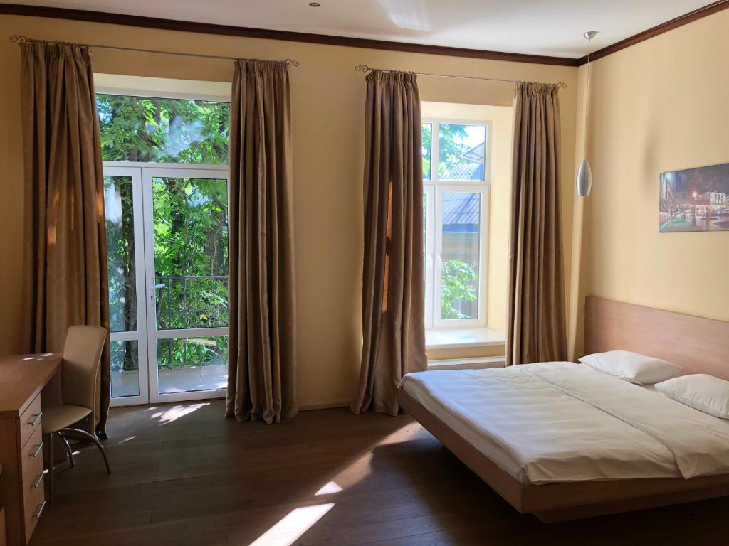 A bed or beds in a room at Vorontsov Apartments