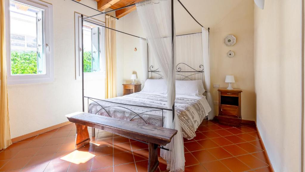 A bed or beds in a room at Antico Brolo