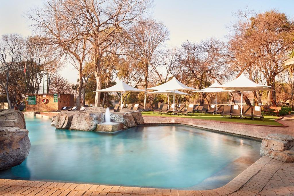 The swimming pool at or near First Group Magalies Park