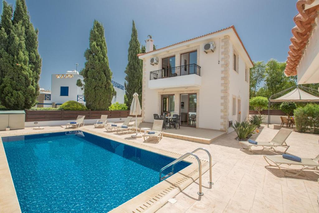 The swimming pool at or near Zouvanis Luxury Villas