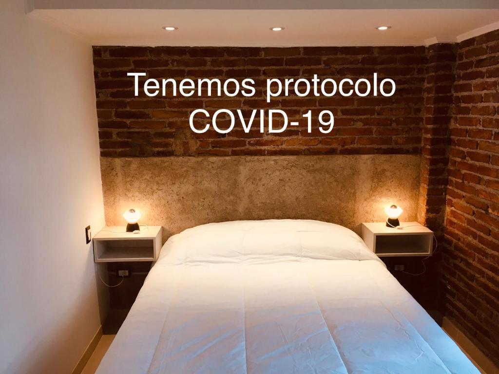 Una cama o camas en una habitación de Munay Posada y Cabaña