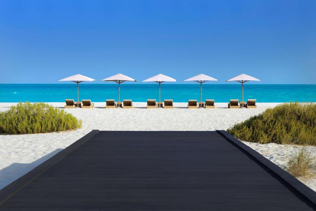 The swimming pool at or near Park Hyatt Abu Dhabi Hotel and Villas