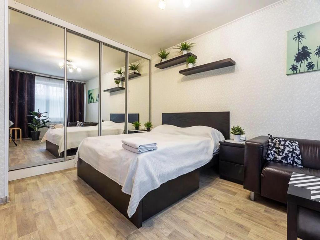 Кровать или кровати в номере Апартаменты Ханака Щёлковское 46