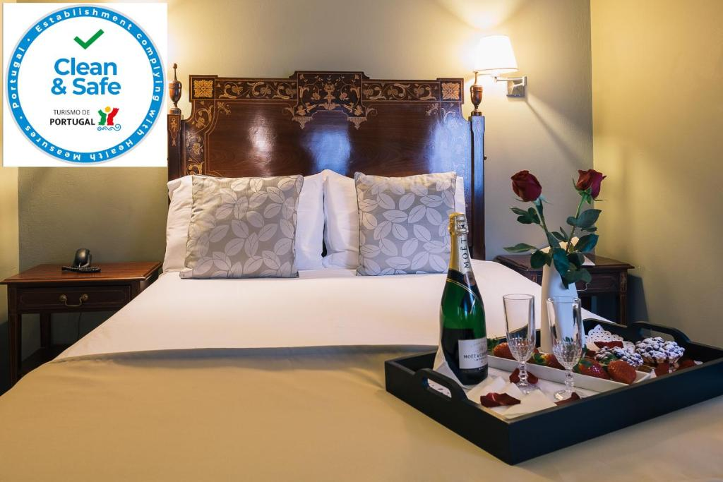 A bed or beds in a room at Hotel Sao Jose