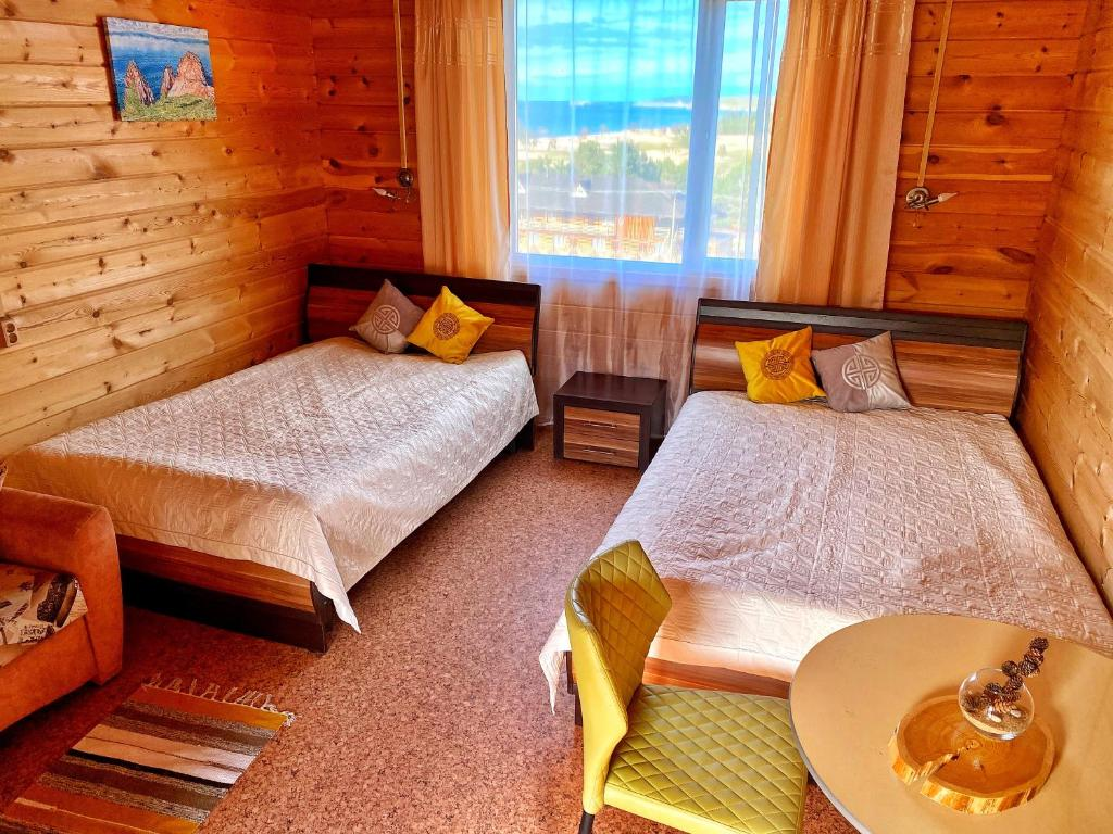 A bed or beds in a room at Baikal Terra Hotel