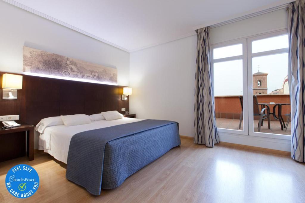 Cama o camas de una habitación en Ganivet