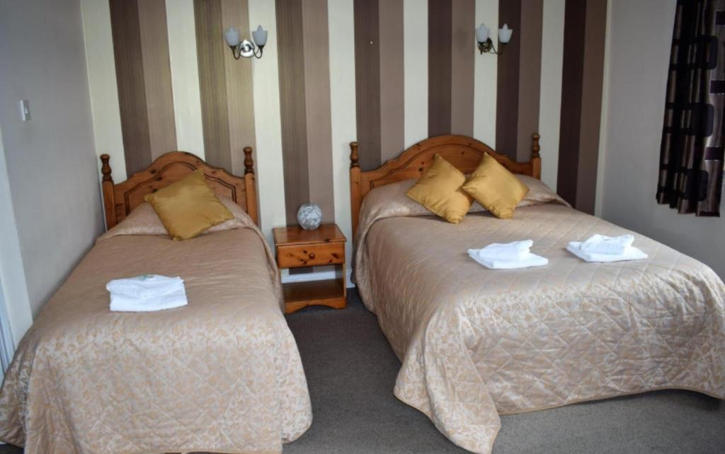 A bed or beds in a room at The Lodge Country Inn