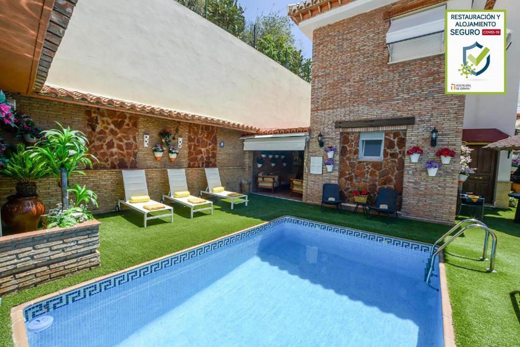The swimming pool at or near Apartamentos Turísticos Tronca Luxury