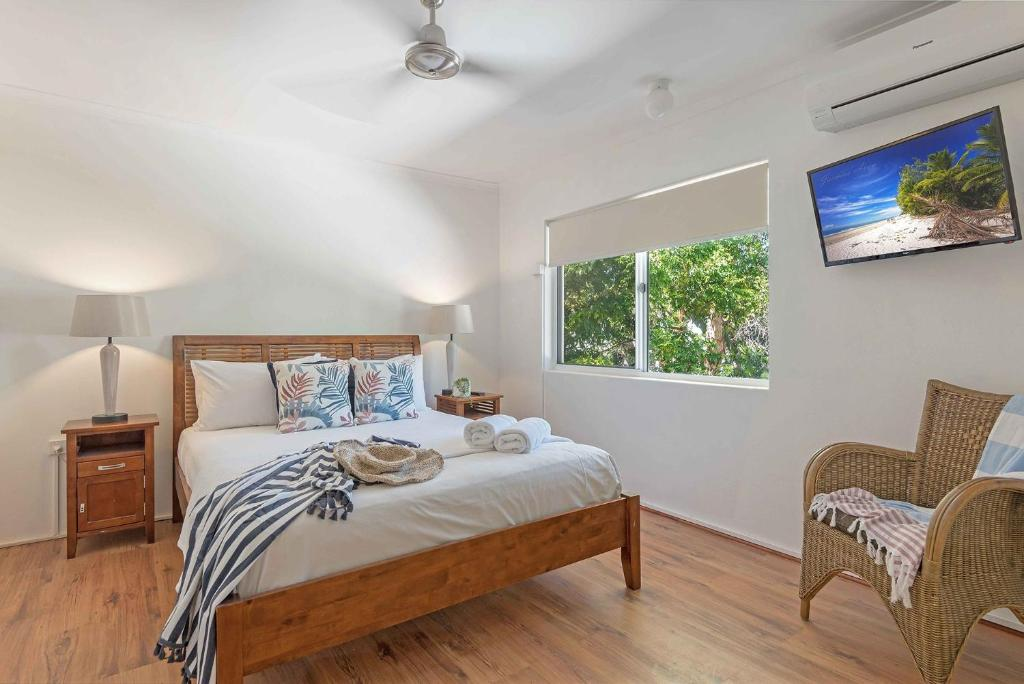 A bed or beds in a room at Marina Terraces Port Douglas