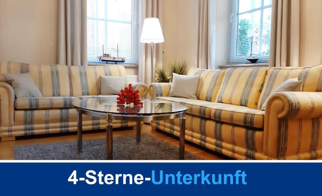 Ein Sitzbereich in der Unterkunft Villa Lotsenberg