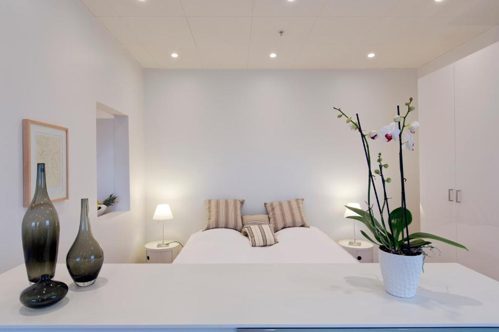 A bed or beds in a room at Europahuset Luxury Apartments