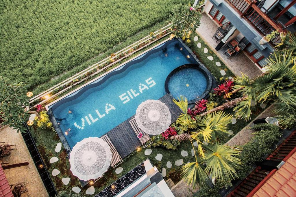 A view of the pool at 巴厘岛乌布塞拉斯花园度假酒店 Villa Silas or nearby