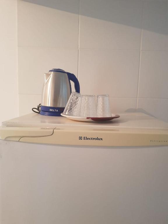 A kitchen or kitchenette at Apartamento de apoio
