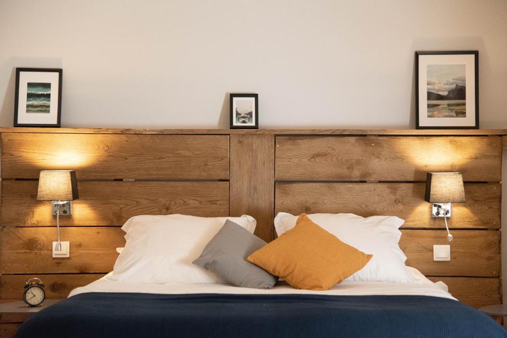Un ou plusieurs lits dans un hébergement de l'établissement Hôtel Montmirail