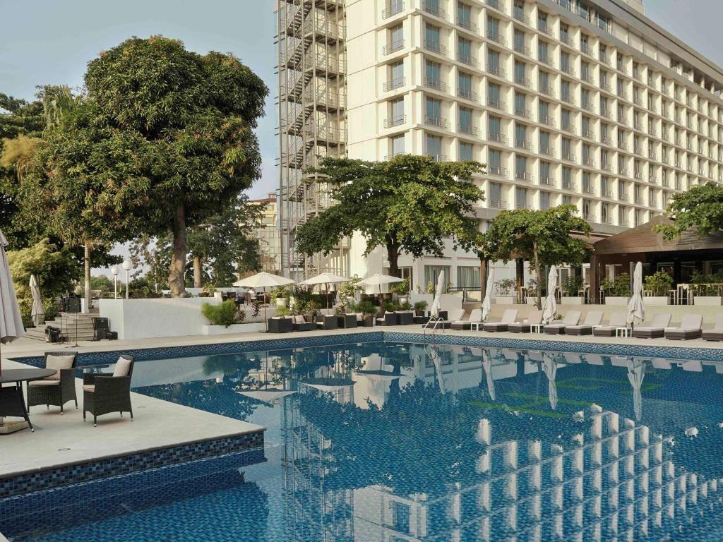 The swimming pool at or near Pullman Kinshasa Grand Hotel