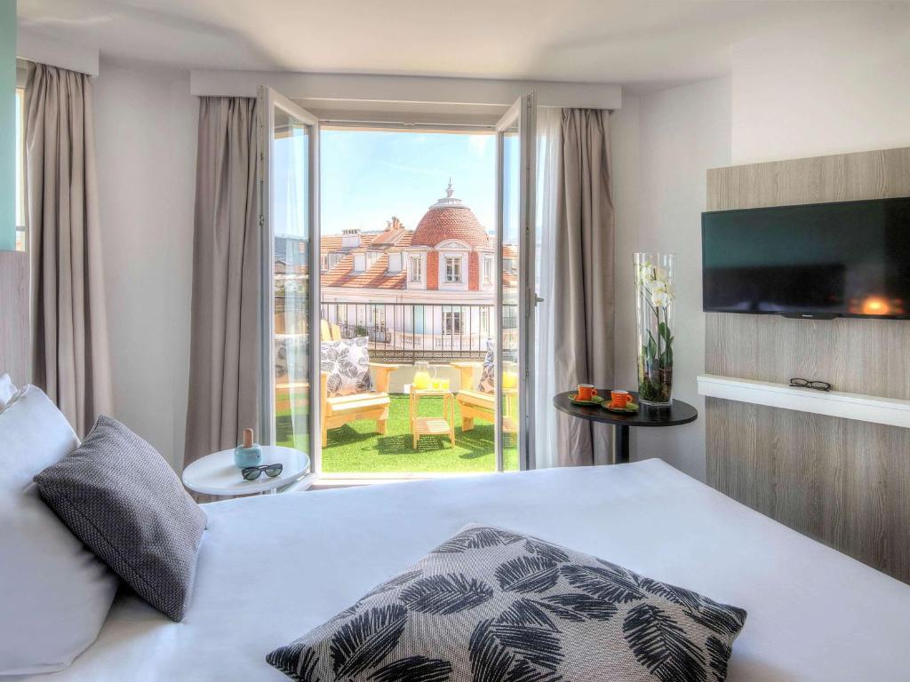 Ibis Styles Nice Centre Gare tesisinde bir odada yatak veya yataklar
