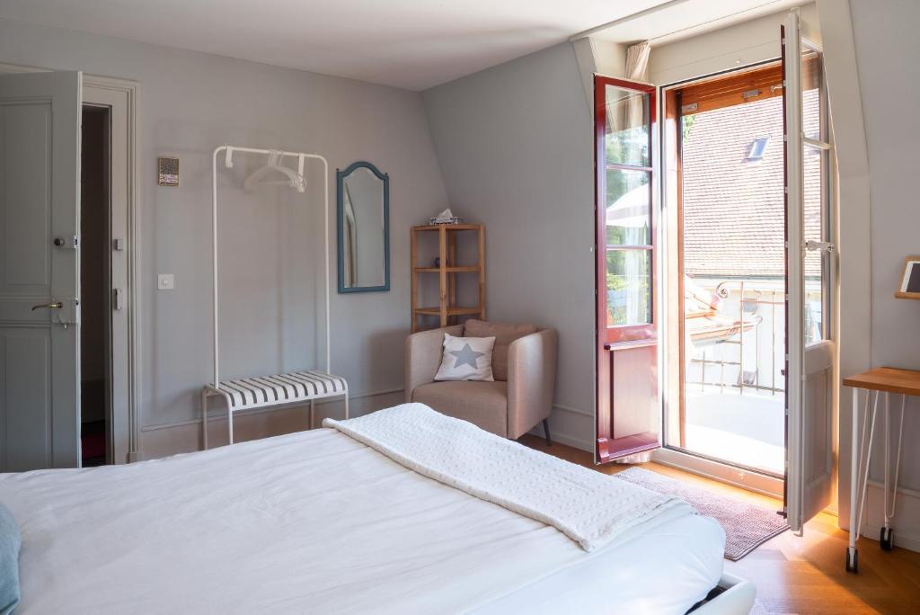 Ein Bett oder Betten in einem Zimmer der Unterkunft B&B The B