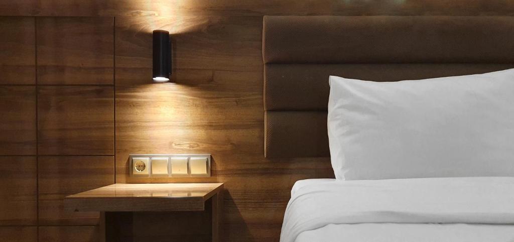 Кровать или кровати в номере Ozgur Bey Spa Hotel