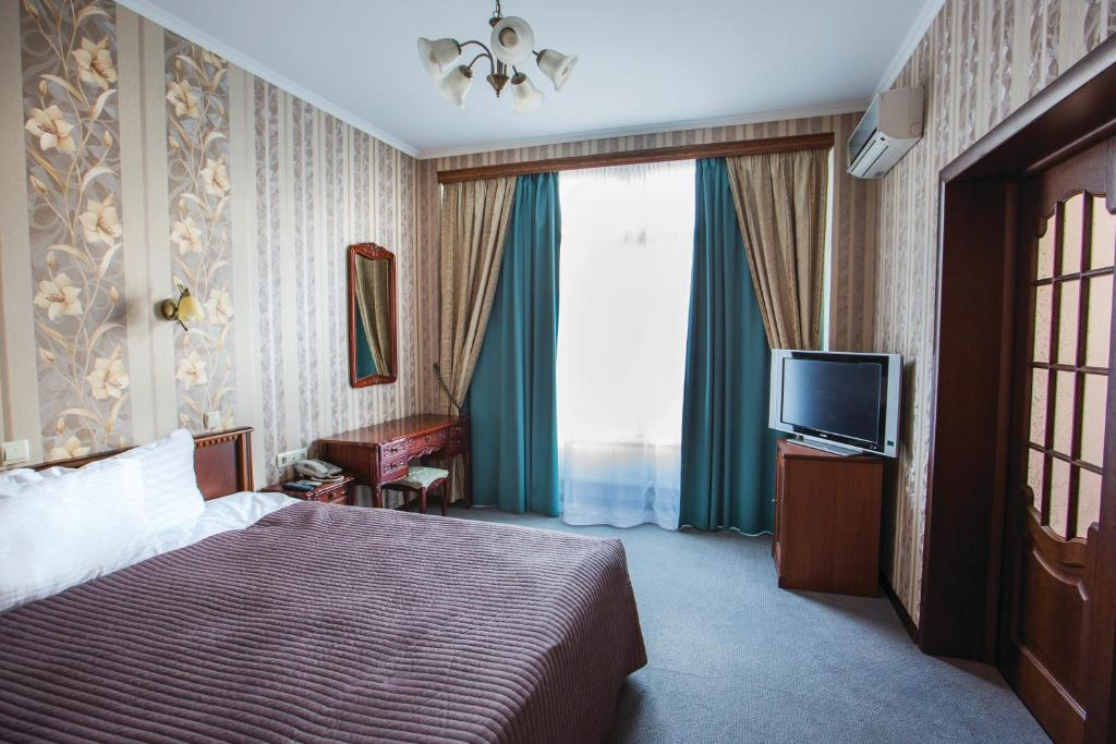 A bed or beds in a room at Dnipro Hotel