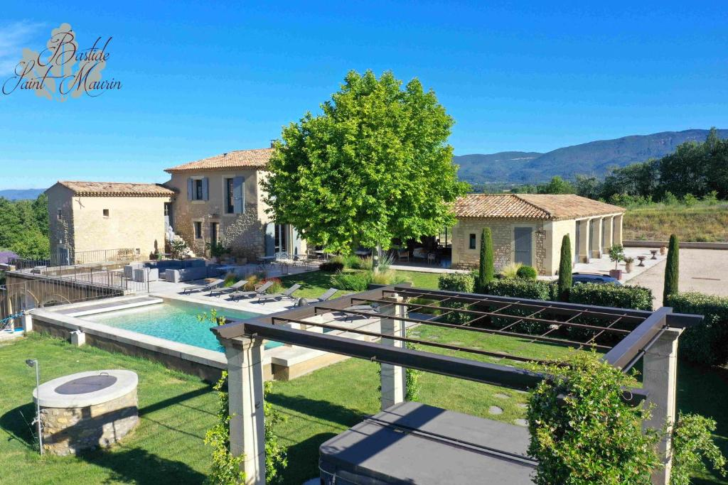 A view of the pool at Bastide Saint Maurin or nearby